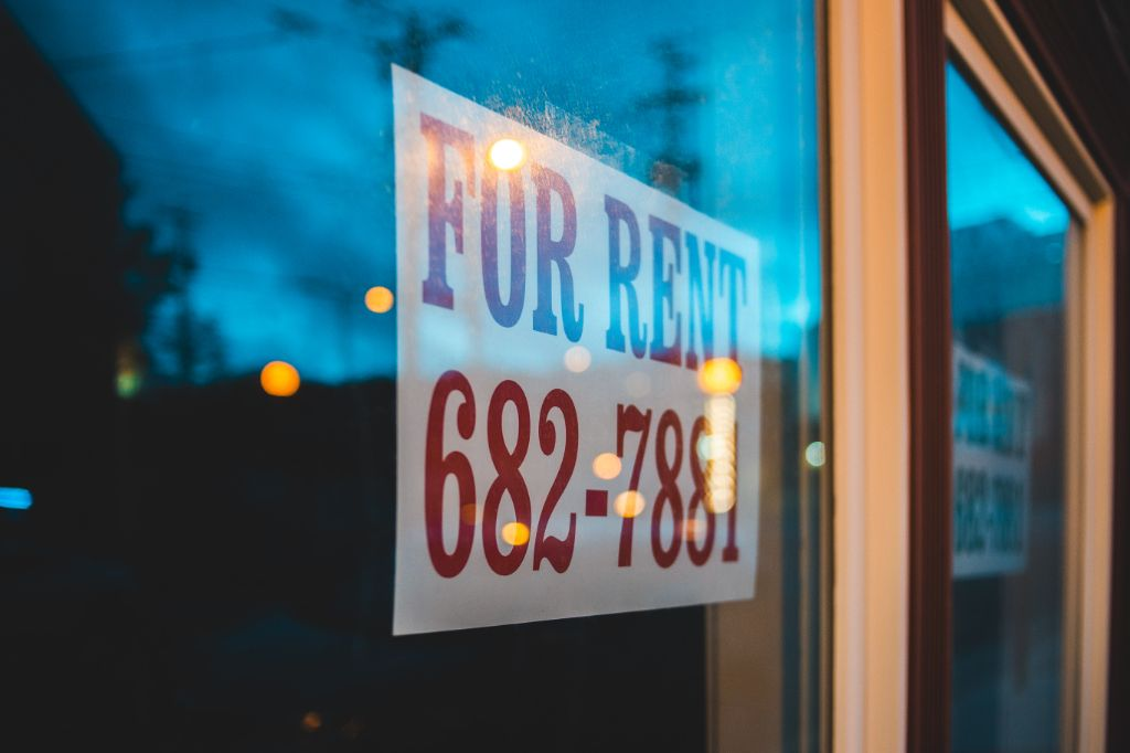 For rent sign and a phone number, representing renting out a spare room for extra income