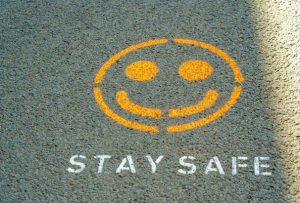 A stay safe sign that signifies how the pandemic has affected the market and home downsizing