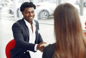 Real estate agent shaking hands with a client