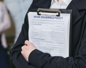 Man holding a home insurance policy